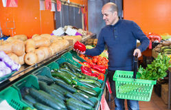 Portrait of mature man purchasing seasonal veggies Stock Photography