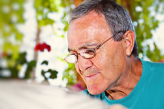 Portrait of a Mature Man Reading Stock Image