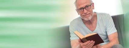Portrait of mature man reading a book, light effect. Portrait of mature man reading a book at home, light effect Stock Images