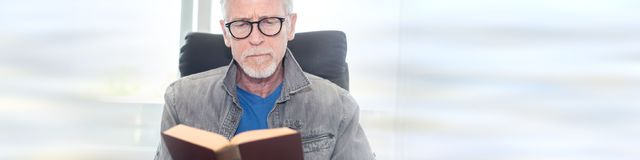 Portrait of mature man reading a book royalty free stock images
