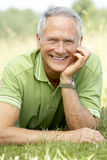 Portrait of mature man relaxing in countryside Royalty Free Stock Image
