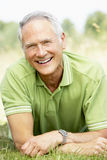 Portrait of mature man relaxing in countryside Royalty Free Stock Photography
