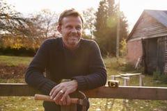 Portrait Of Mature Man Repairing Garden Fence Stock Photography