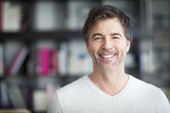 Portrait Of A Mature Man Smiling At The Camera. Home royalty free stock images