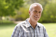 Portrait of mature man smiling outdoors royalty free stock photos