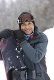 Portrait of mature man with snowboard stock photo