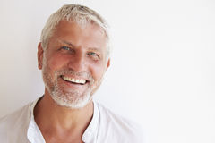 Portrait Of Mature Man Standing Against Wall Stock Photography