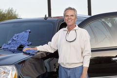 Portrait of mature man standing next to his car Royalty Free Stock Image