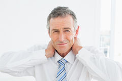 Portrait of a mature man suffering from neck pain Stock Photos