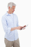 Portrait of a mature man using a tablet computer Royalty Free Stock Images