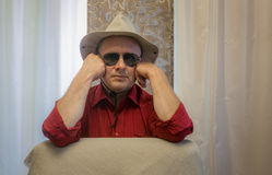 Portrait of mature man wearing hat and black sunglasses Royalty Free Stock Images
