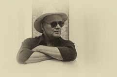 Portrait of mature man wearing hat and black sunglasses Stock Image