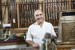 Portrait of a mature merchant in gun shop Stock Photo