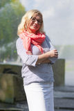 Portrait of Mature Middle Aged smiling Blond Woman Wearing Spectacles Posing Outdoors in Park. Middle Aged Females Concepts. Portrait of Mature Middle Aged Stock Photos