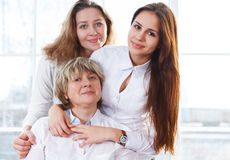 Portrait of a mature mother and adult daughter and teen granddau. Close up portrait of a mature mother and adult daughter and teen granddaughter being close and Stock Photos