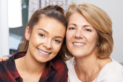 Portrait Of Mature Mother With Teenage Daughter Stock Photo