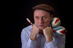 Portrait of mature musician with Ukrainian woodwind instrument sopilka Royalty Free Stock Photo