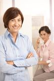 Portrait of mature office worker smiling at camera Royalty Free Stock Images