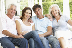 Portrait Of Mature Parents Relaxing With Grown Up Children stock photo