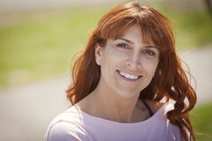 Portrait Of A Mature Red woman smiling Royalty Free Stock Images