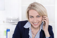 Portrait of a mature or senior business woman flirting on mobile Stock Photo