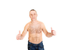 Portrait of mature shirtless man with ok sign Stock Images
