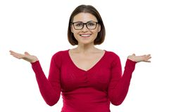 Portrait of mature smiling woman with glasses raised her hands up, showing something on the palm of her hand, white background iso. Lated royalty free stock photos