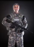 Portrait Of A Mature Soldier Holding Gun Stock Photography