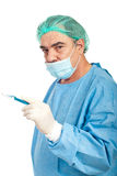 Portrait of mature surgeon with scalpel Stock Photography