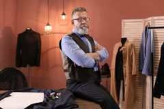 Portrait of mature tailor. In atelier Royalty Free Stock Photos