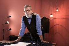 Portrait of mature tailor. In atelier Stock Image