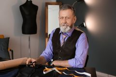 Portrait of mature tailor. In atelier Stock Photo