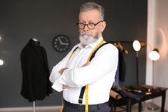 Portrait of mature tailor. In atelier Royalty Free Stock Photography