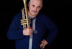 Portrait of mature trumpeter Stock Photography