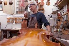 Portrait of mature violin maker Royalty Free Stock Images