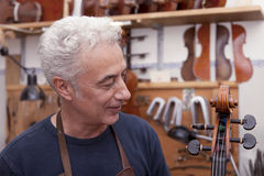 Portrait of mature violin maker Royalty Free Stock Image