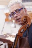 Portrait of mature violin maker Stock Photography