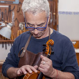 Portrait of mature violin maker Royalty Free Stock Photo