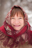 Portrait of mature woman in babushka Stock Photo