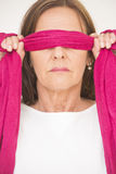 Portrait mature woman blindfolded Stock Photo