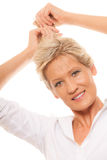 Portrait mature woman blonde holding her long hair Stock Image