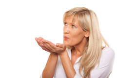Portrait of mature woman blowing a kiss isolated Royalty Free Stock Images