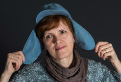 Portrait of mature woman in blue cap being happy Royalty Free Stock Photo