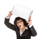 Portrait of mature woman with box, wearing glasses, looking at c Royalty Free Stock Photography