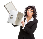Portrait of mature woman with box, wearing glasses, looking at c Royalty Free Stock Photo