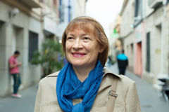 Portrait of mature woman in city street Royalty Free Stock Photography