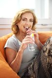 Portrait of a mature woman enjoying a drink at a restaurant Stock Photo
