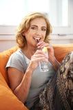 Portrait of a mature woman enjoying a drink at a restaurant Stock Photo
