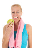 Portrait mature woman at fitness eating an apple Royalty Free Stock Photography