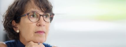Portrait of a mature woman with glasses, horizontal photo banner royalty free stock photo